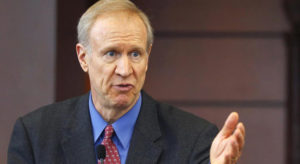 Illinois governor signs bill to crack down on criminals who are repeat gun offenders