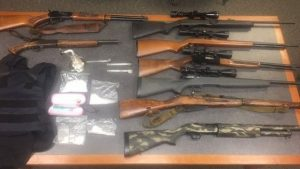 Search for fugitive turns up $16K worth of meth, other drugs, guns