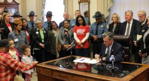 Delaware governor signs straw purchaser bill as other gun measures stall